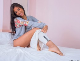 Karin Torres is a fresh faced babe with a teen body that is always primed to cum. Don\'t miss out as she peels off her thong and admires her perky natural breasts and flat belly in the mirror before laying down on the bed and running her finger up and dow
