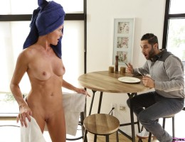 Sofie Marie is looking good as she admires herself in the mirror after stepping out of the shower. She covers her body back up when she hears her stepson Damon Dice calling her to prepare his breakfast. The towel drops as they talk, and Sofie can\'t help
