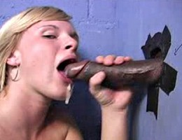 Blond sucks off a black dick in gloryhole eats cum