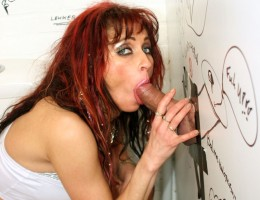 Skanky redhead slut enjoys a gloryhole cock inside her slit