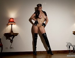 Busty stewardess in latex licks and pinches her titties!