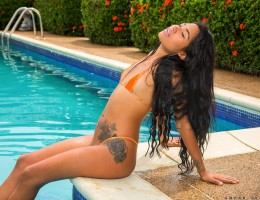 Get ready for Venezuelan student Ambar Suarez. This hot Latina babe models a micro bikini by the pool, and then slides off the pieces one at a time until she\'s totally nude. Getting out of the water, she spreads her legs and goes to work on her greedy ba