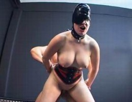 masked babe dressed in leather collar and latex corset gets her twat hammered hard