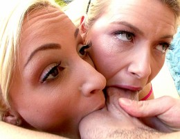 Two beautiful blondes suck every inch of performer\'s cock.