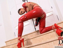 Black Angelica in Red latex with a big black cock struttin!