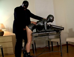 Latex beauty gets her pussy banged hard in a bondage box