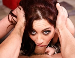 Naughty redhead Jessica deep throats a thick cock.