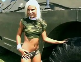 Army teenie girl toying her tight pink pussy near a tank