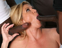 Veteran and superwhore, Ginger Lynn, gets several samplings of young, black cocks