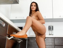 The kitchen is a perfect place for lusty Cira Nerri to indulge in all of her horniest fantasies. She starts by playing with her miniskirt dress and gradually working it up and off. Her thong is the next thing to hit the ground, leaving her wearing just he