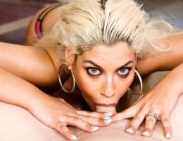 Busty Spanish slut Bridgette B shoves a cock down her throat