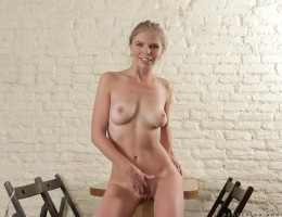 Sensual blonde babe Ekaterina Anasova is a Russian hottie with attitude! Don\'t miss out on her athletic curves as she peels off her miniskirt dress and then her panties so that she can show off her tan lines to the world before spreading her thighs to re