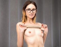 Glasses and demure clothes give off a hint of cute nerdiness for Sade Mare, but the Ukraine coed is not all about studying. Instead, she wants you to enjoy a lesson in sex as she lifts her shirt to show her soft breasts with their hard nipples and then sl