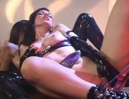 Superb mistress in latex rubbing and fingering her pussy