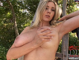 Busty blonde babe Sapphire posing her shaved pussy outdoors