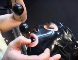 latex masked slut sucking cock and balls covered anal juice