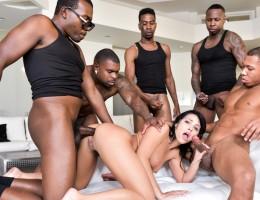 Horny Adriana has her first ever interracial gang bang.