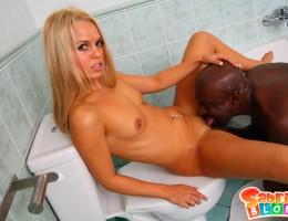 Teen sucks and fucks big black cock in the toilet