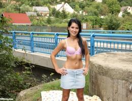 Teenage cutie publicly masturbating near a bridge outdoors