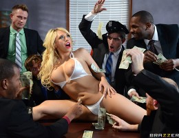 This time on Porno P.I., Kagney has tracked the head of the corrupt ZZ Corporation down to an office building on the bad side of town. Posing as a stripper, Kagney slips into the meeting and starts gathering intelligence while she gives all the shady gang