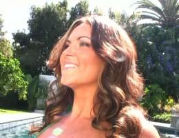 Sarah Randall poses poolside in holiday bikini