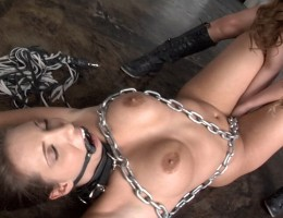 Lexi straps on a huge cock and fucks Kelly deep in her ass