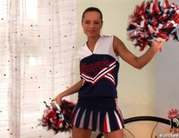 Sexy cheerleader Kari stripping naked on bed showing pussy