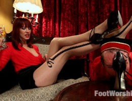 A goofy bellhop is made to worship, lick, suck, sniff and clean a gorgeous guests feet and then she gives him a oily foot job and makes him lick her f