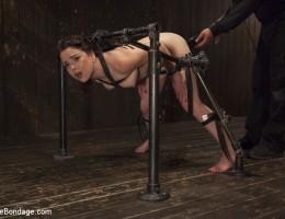 Young slut is brutalized in extreme bondage.