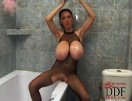 Beautiful busty babe Merilyn Sekova soloing naked in pool