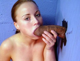 Teen sucks off black dick in pornshop gloryhole
