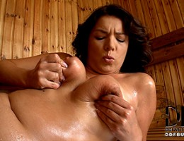 Rye plays with her 36D cannons and twat in the dry sauna
